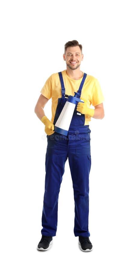 Portero de sexo masculino con la botella del espray de producto de limpieza foto de archivo libre de regalías