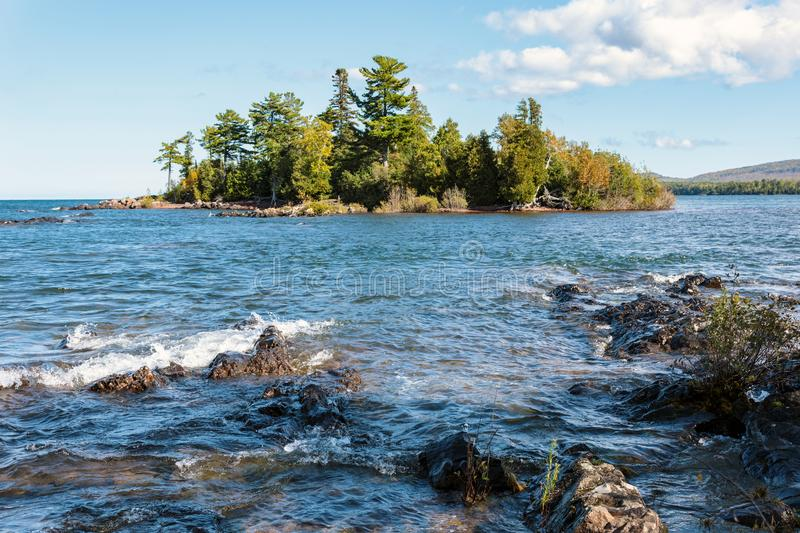 Porters Island - Copper Harbor in Michigans Keweenaw Peninsula. The clear, blue waters of Lake Superior surround Porter`s Island at Copper Harbor in Michigan`s stock photos