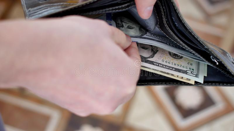 Portfel z USA dolarami wśrodku obraz stock
