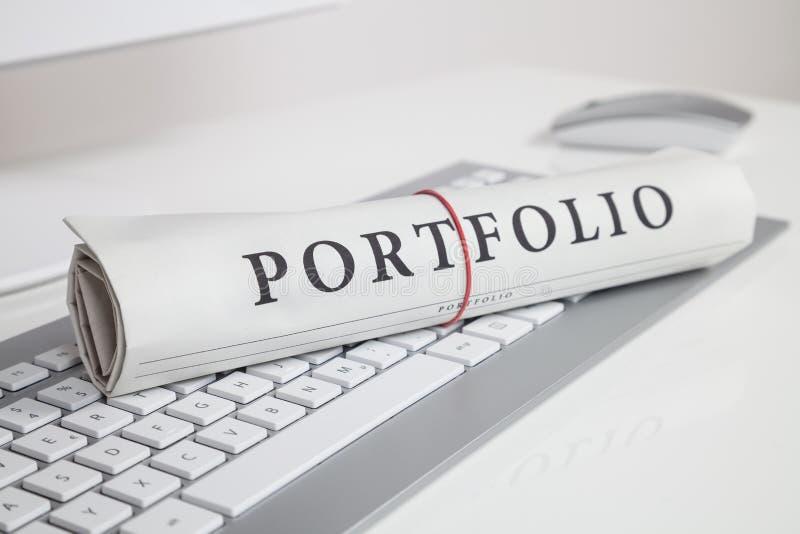Portfolio written on newspaper stock photos