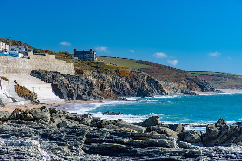Porthleven beach and cliffs on a sunny day royalty free stock image