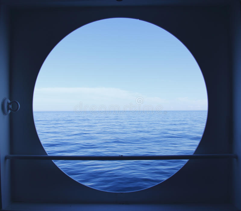 Porthole with ocean view stock photography