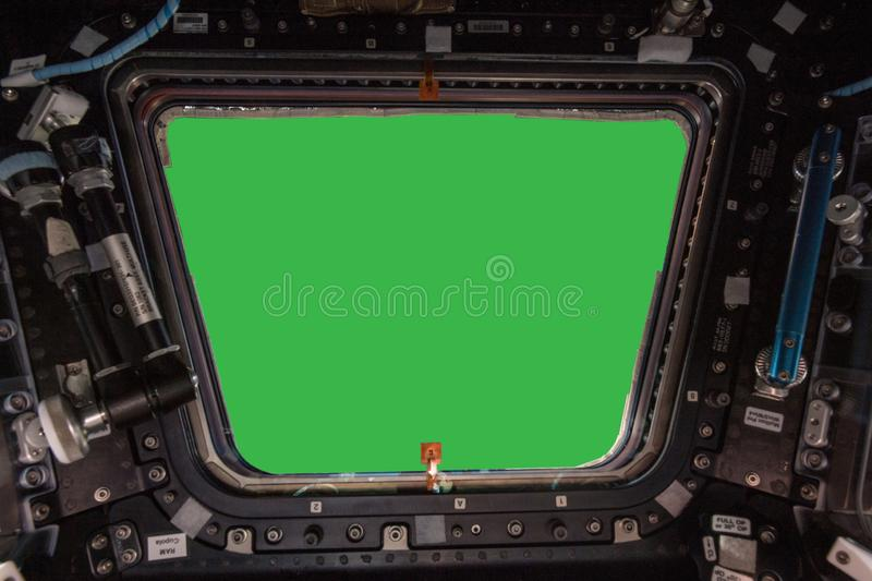 Porthole of space station isolated on green background. Elements of this image furnished by NASA.  stock image