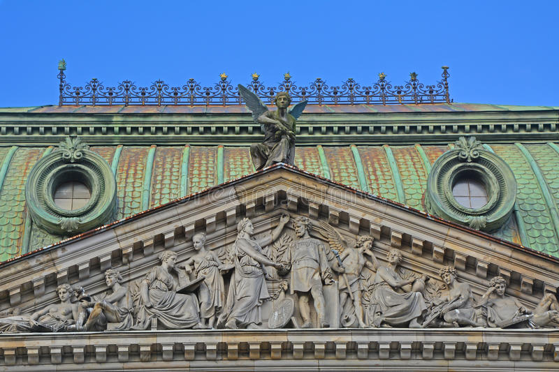 Portico with bas-relief of the Central school of technical drawing of the baron Shtiglits in Saint Petersburg, Russia stock photography