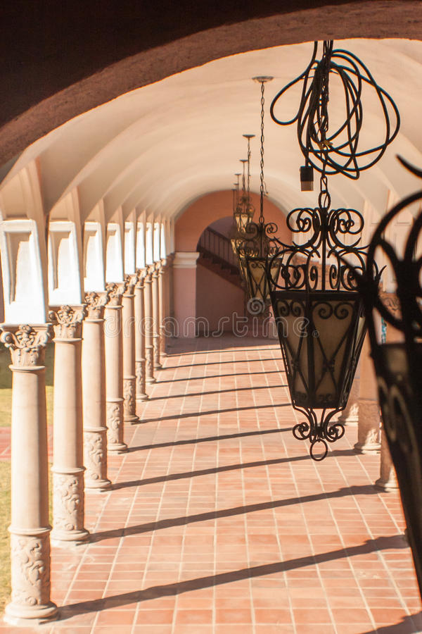 Portico Pillars. Pima County Courthouse in Tucson features pillars, arches, Spanish tile and lamps in Mission Revival and Spanish Colonial Revival architecture stock images