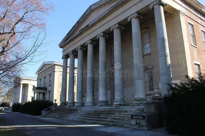 Porticos and columns of the 19th century historic buildings at the Snug Harbor, Staten Island. NY, USA - March 4, 2020 royalty free stock photos