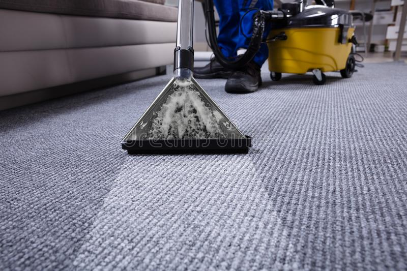 Portier Cleaning Carpet image stock