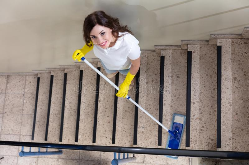 Portier Cleaning Staircase royalty-vrije stock foto