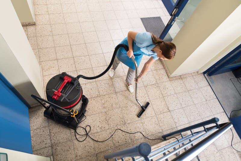 Portier Vacuuming Floor images libres de droits