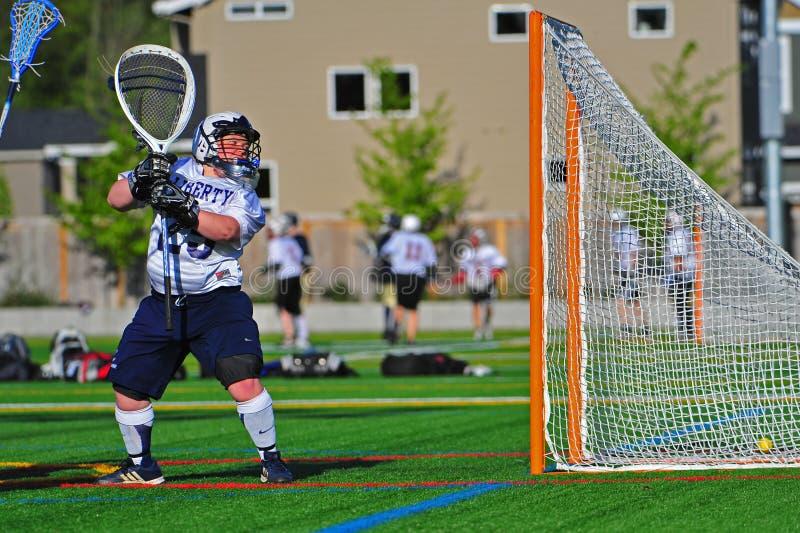 Portiere di Lacrosse delle ragazze immagini stock libere da diritti