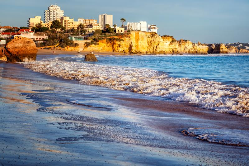 Portimao, city on the Atlantic coast at sunset, red cliffs and s stock image