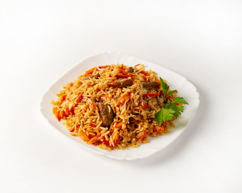 Portion of beef pilaf, decorated with parsley on white background royalty free stock image