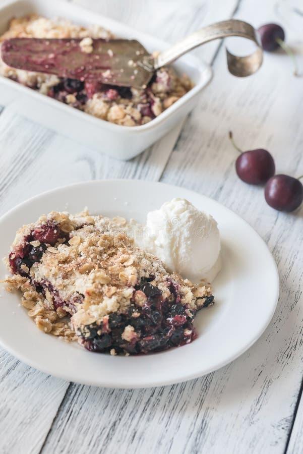 Berry crumble with vanilla ice cream. Portion of berry crumble with vanilla ice cream stock image