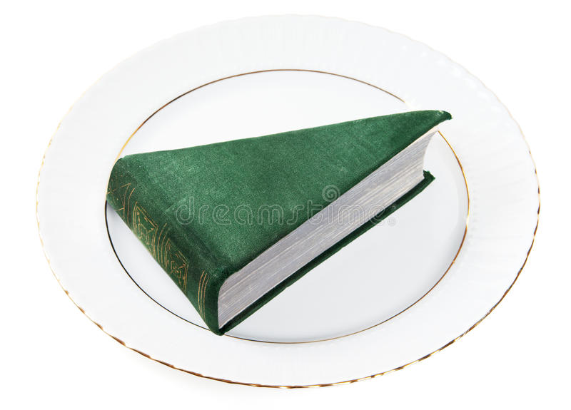 Portion of book. (as dessert) on plate isolated on white stock photos
