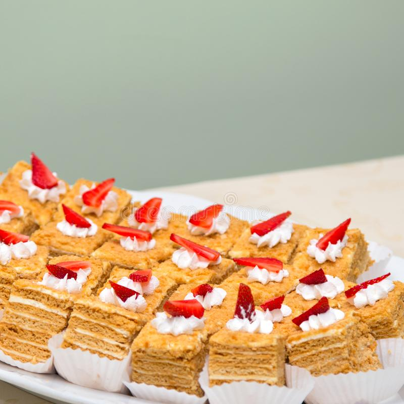 Portion cakes with strawberries and cream. Sweet food, dessert royalty free stock photos