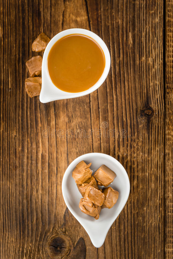 Portion of Caramel Sauce. Caramel Sauce on a vintage background as detailed close-up shot selective focus royalty free stock image