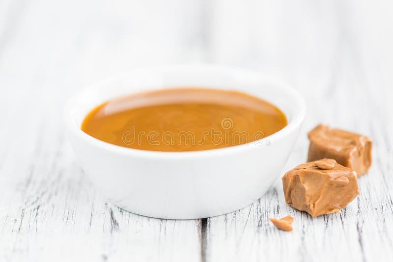 Portion of Caramel Sauce. Caramel Sauce on a vintage background as detailed close-up shot selective focus stock photos