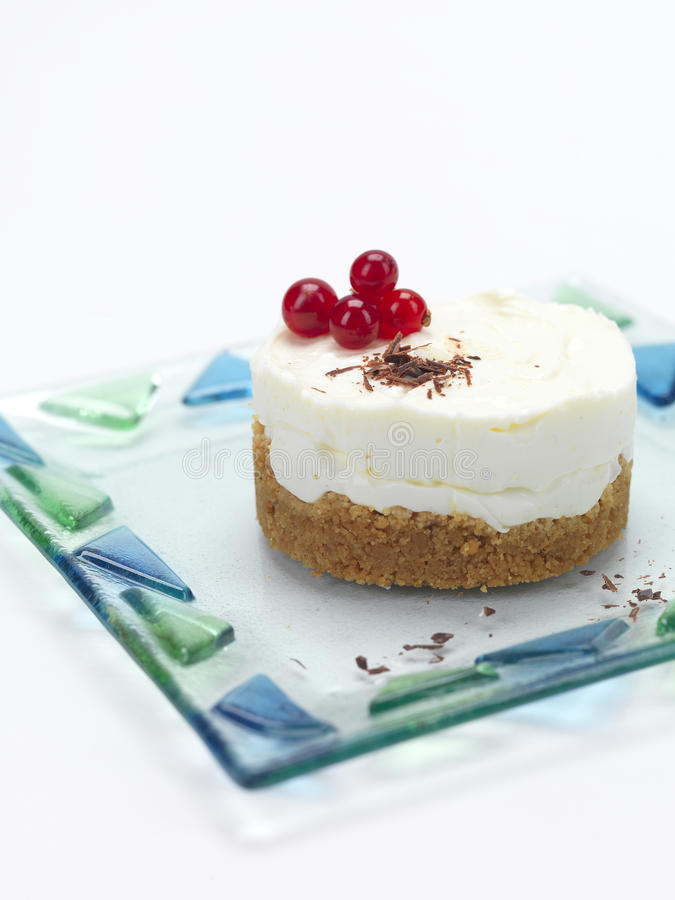 Portion of a cheese cake with cranberries royalty free stock photo