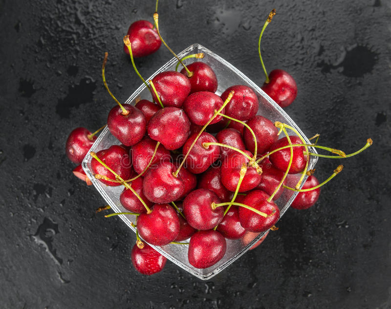 Portion of Cherries on a slate slab. Some Cherries on a slate slab as detailed close-up shot; selective focus royalty free stock photography