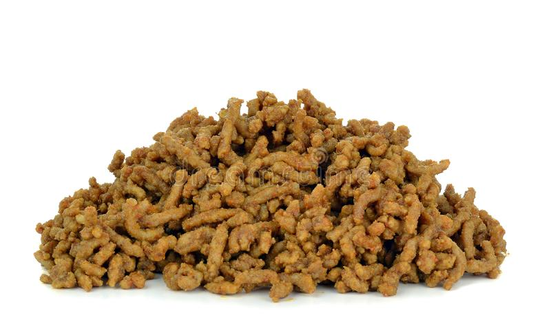 A portion of cooked minced meat. On a white background stock photography