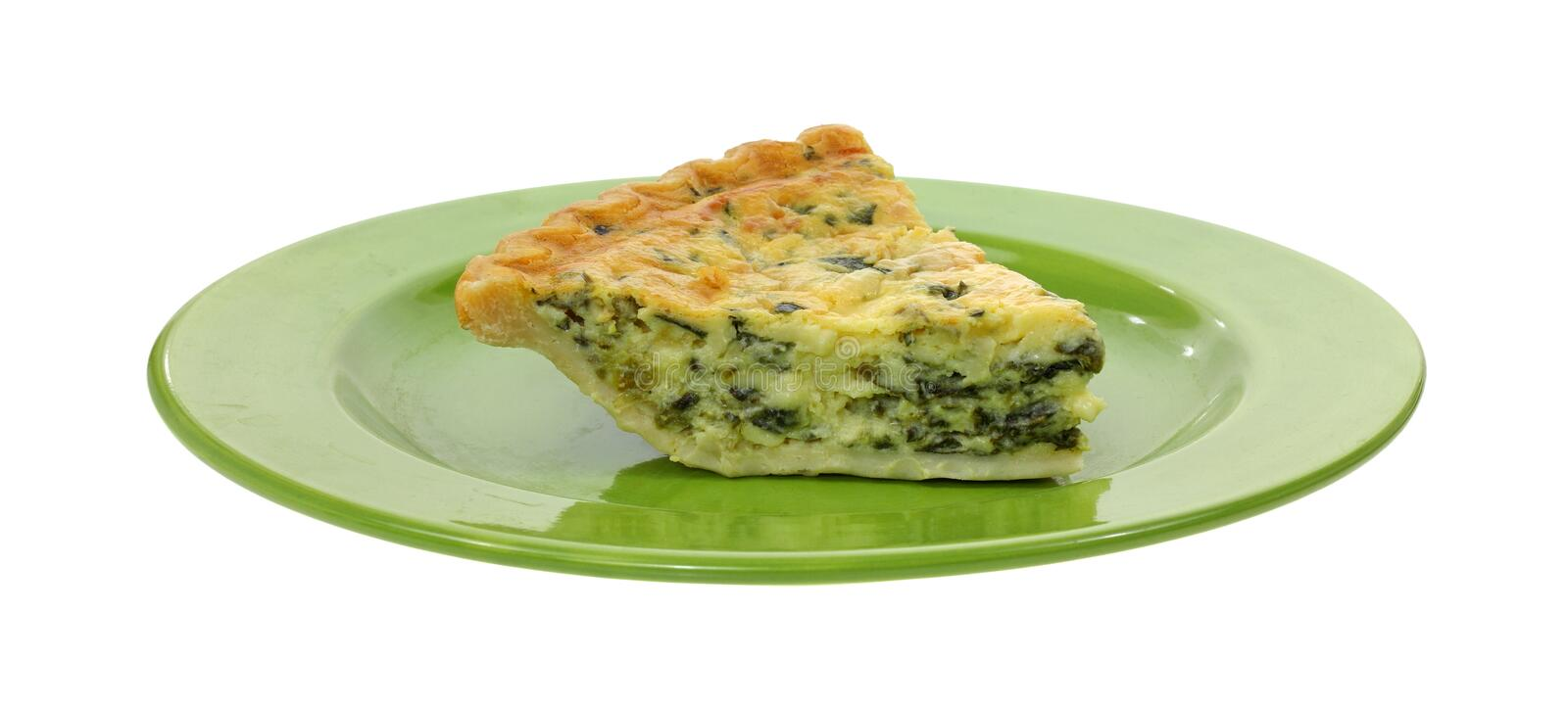Portion de quiche d'épinards de plaque verte image stock