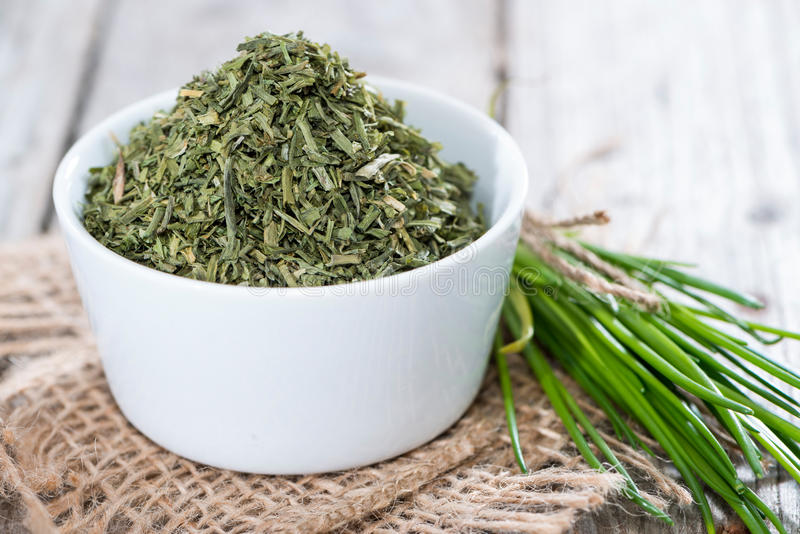 Download Portion Of Dried Chive (in A Bowl) Stock Photo - Image of closeup, kibbled: 39515686