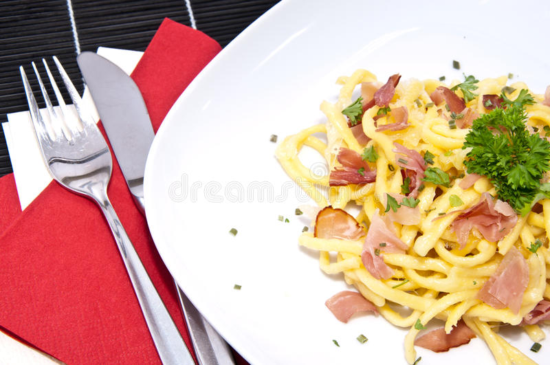 Portion Of Fresh Cheese Spaetzle On Black Stock Images