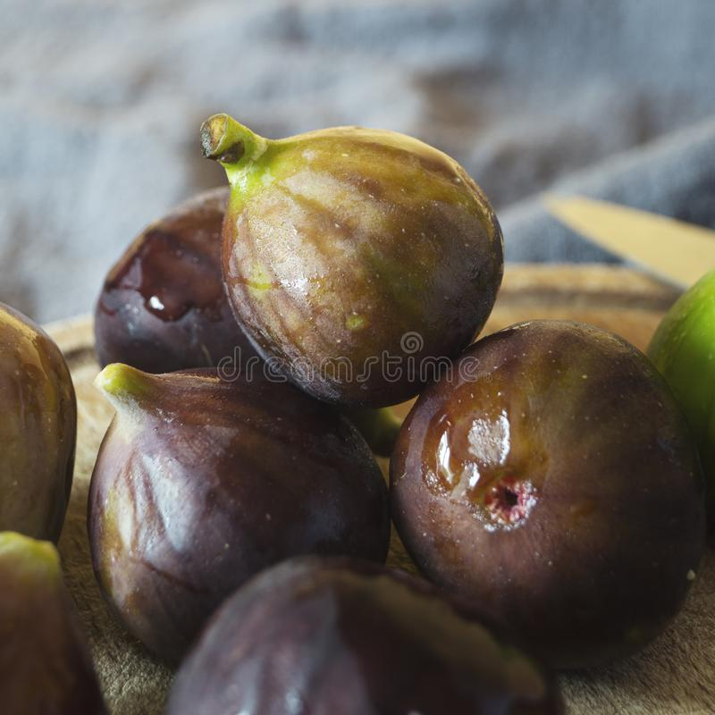 Portion of fresh Figs on cutting board. Close up stock image