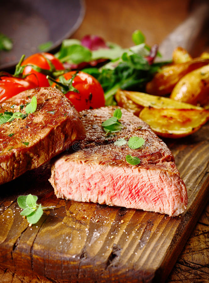 Portion of healthy grilled beef steak stock images