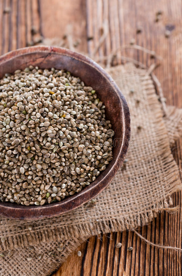 Portion of Hemp Seeds. (close-up shot) on an old wooden table stock photos