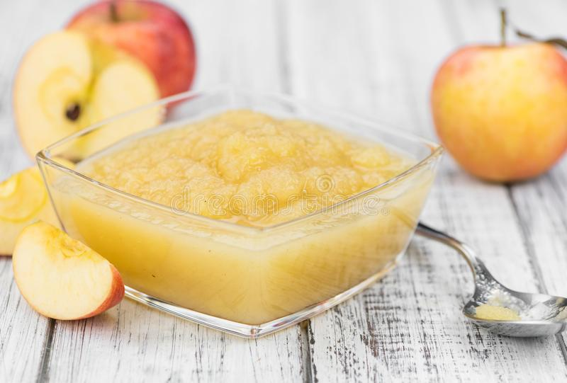 Portion of homemade Applesauce selective focus stock images
