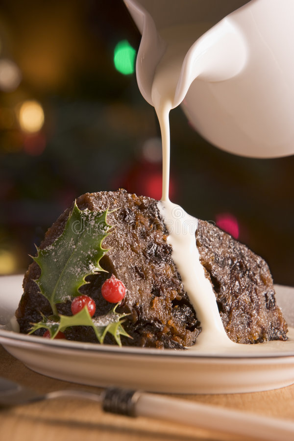 Free Portion Of Christmas Pudding With Pouring Cream Stock Images - 5604714