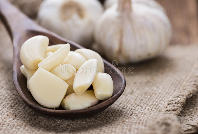 Portion of peeled Garlic royalty free stock photos