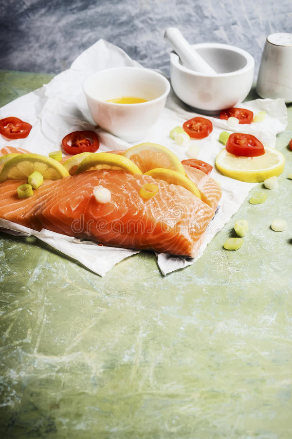 Portion piece of salmon fish with lemon and cooking royalty free stock photography