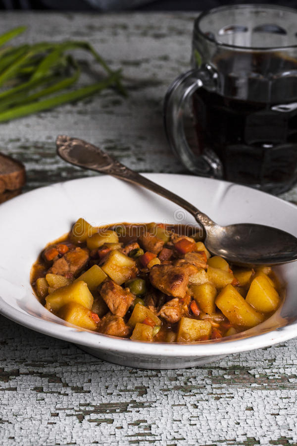 Portion of traditional irish beef, guinness beer stew with carrots and potato stock images