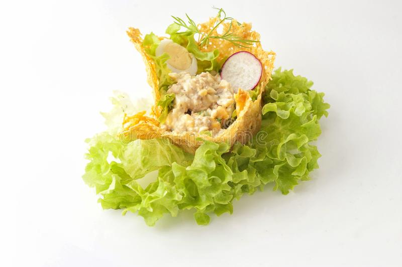 Portioned snack in baked crispy cheese tartlet. Close up and horizontal view stock images