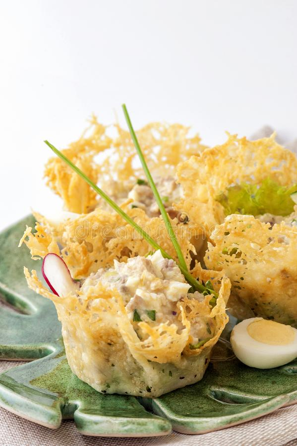 Portioned snack in baked crispy cheese tartlet royalty free stock image