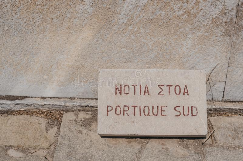Close up of the Portique Sud `Portico of the South` sign on the island of Delos, Greece. An archaeological site near Mykonos in the Aegean Sea Cyclades royalty free stock photography