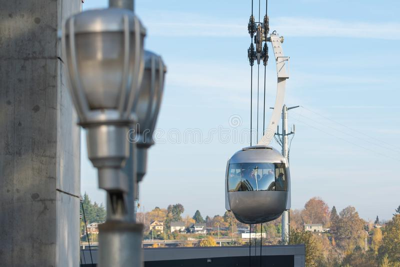 Portland AirTram aerial lift transport cabin. Portland, OR / USA - November 15 2018: Portland AirTram aerial lift transport cabin taking people up to the hill stock photo