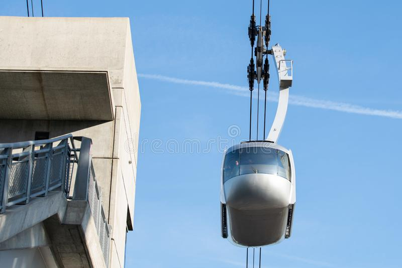 Portland AirTram aerial lift transport cabin. Portland, OR / USA - November 15 2018: Portland AirTram aerial lift transport cabin taking people up to the hill stock image
