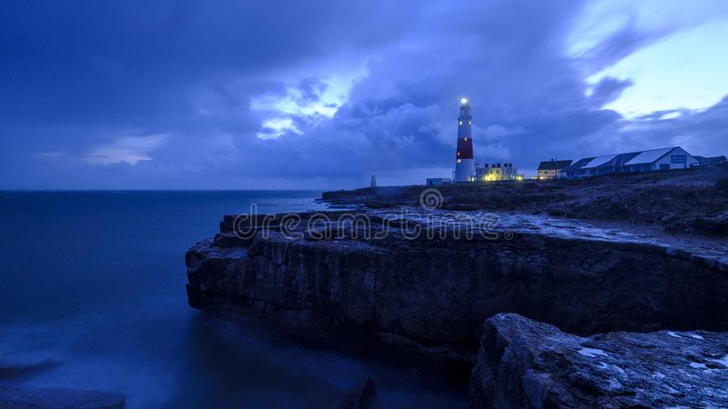 Portland Bill Light house with a stormy sunset stock photos
