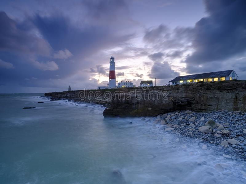 Portland Bill Light house with a stormy sunset stock images
