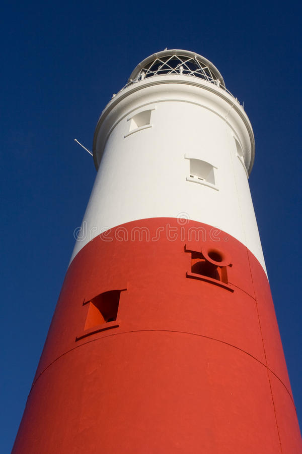 Portland Bill Lighthouse. Looking up at Portland Bill lighthouse tower in Dorset stock photo