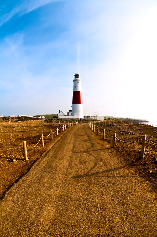 Portland Bill lighthouse. In the early morning light, Centrally placed composition to emphasize sentinel importance royalty free stock photography