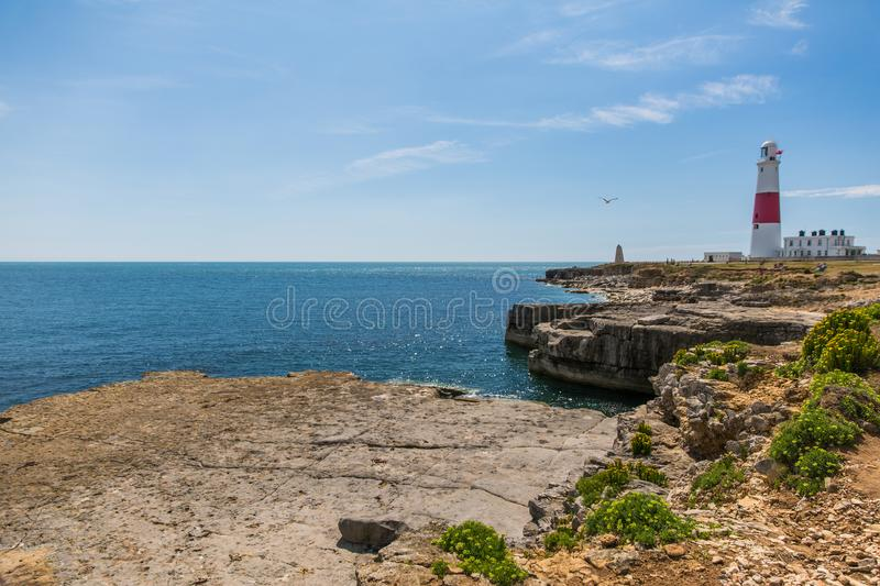 Portland Bill Lighthouse on a Bright Sunny Day with Blue Sky and. Sea royalty free stock image