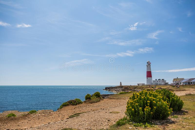 Portland Bill Lighthouse on a Bright Sunny Day with Blue Sky and. Sea stock photos