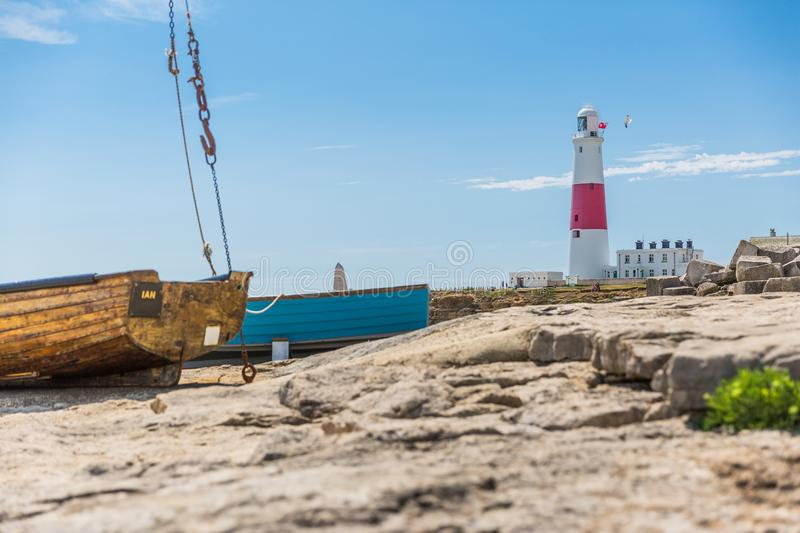 Portland Bill Lighthouse Coast and Boats on a Sunny Day.  stock photo