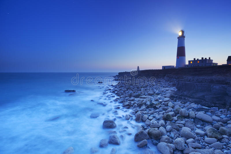 The Portland Bill Lighthouse in Dorset, England at night. The Portland Bill Lighthouse on the Isle of Portland in Dorset, England at night royalty free stock photography
