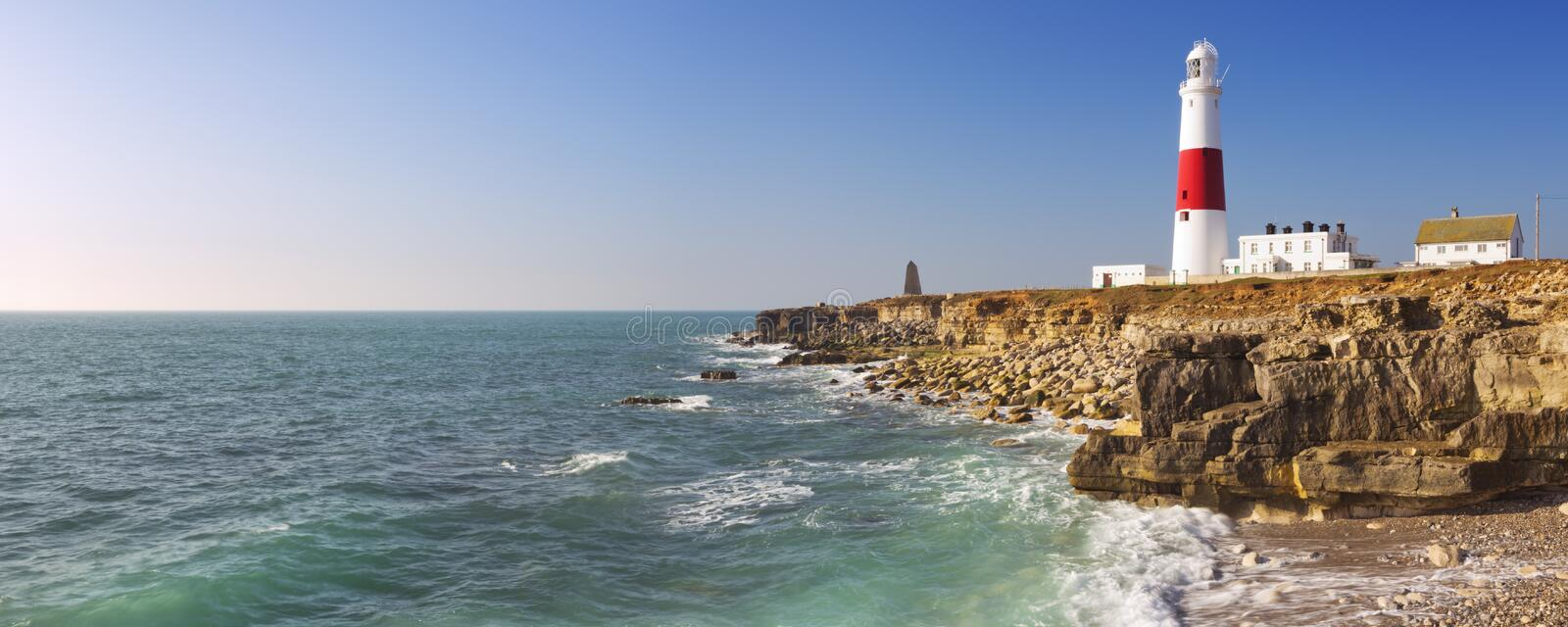Portland Bill Lighthouse in Dorset, England on a sunny day. The Portland Bill Lighthouse on the Isle of Portland in Dorset, England on a sunny day royalty free stock photo