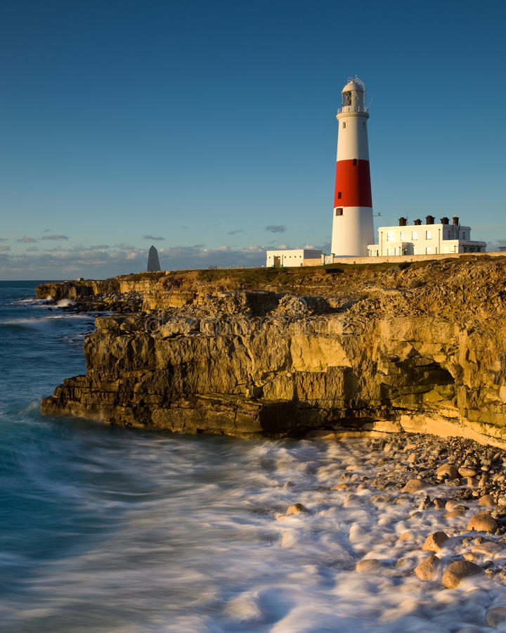 Portland Bill lighthouse, Dorset, UK. Portland Bill lighthouse , Dorset, UK shortly after sunrise in winter royalty free stock images